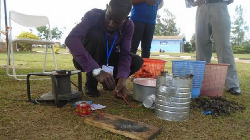 An exhibitor during last week's TVETs expo in Gikondo explains how the 'magical' stove works. (Michel Nkurunziza)