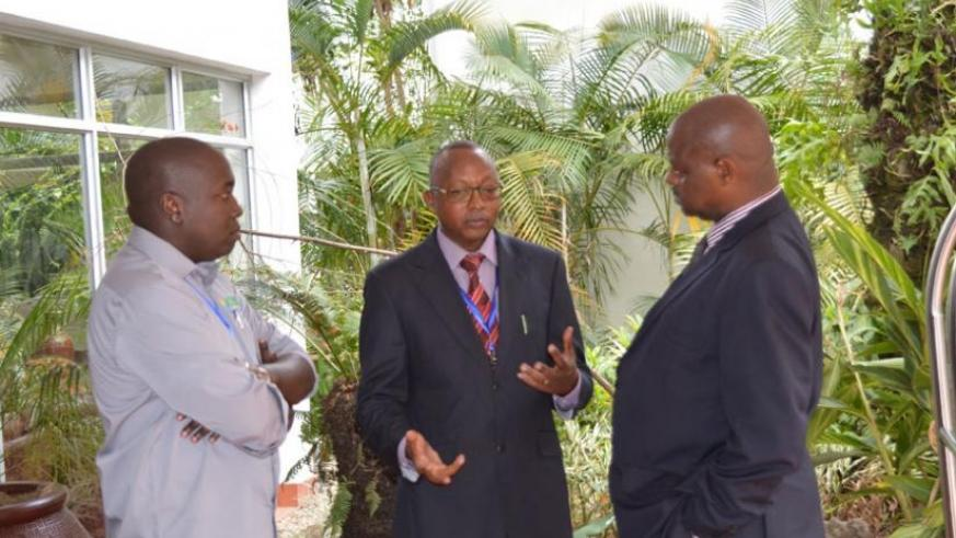 Auditor General Obadiah Biraro (C) chats with Bosco Mukombozi Karake from iCPAR and Cariithi M.Murimi the CEO of Value Directors Limited in Kenya. (Jean d'Amour Mbonyinshuti)