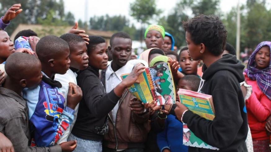 Staff of Ni Nyampinga distribute copies of their magazine to the youth in Nyabihu during the Girl Child Day celebrations in Nyabihu. (Jack Yakubu Nkinzingabo)