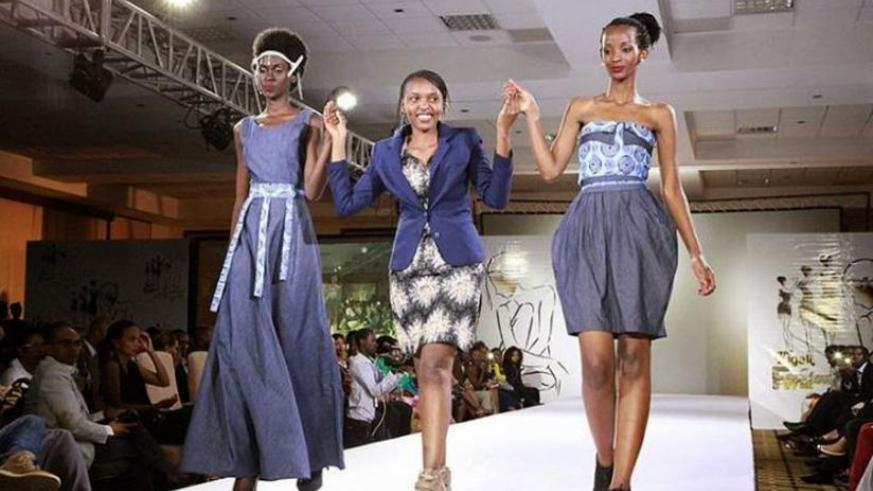 Colombe Ituze Ndutiye, Centre, walks with models clad in her pieces at the Kigali Fashion Week in November, 2013. All photos/ courtesy.
