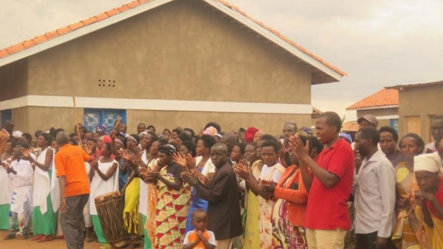 Rwamagana residents welcome visitors during the tour of a model village for the needy families. (S. Rwembeho)