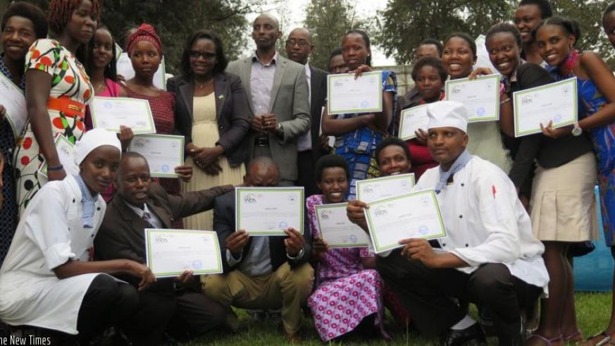 Trainees together with TVET officials pose for a group photo with their certificates at IPRC-South in Huye District on Wednesday. (Emmanuel Ntirenganya)