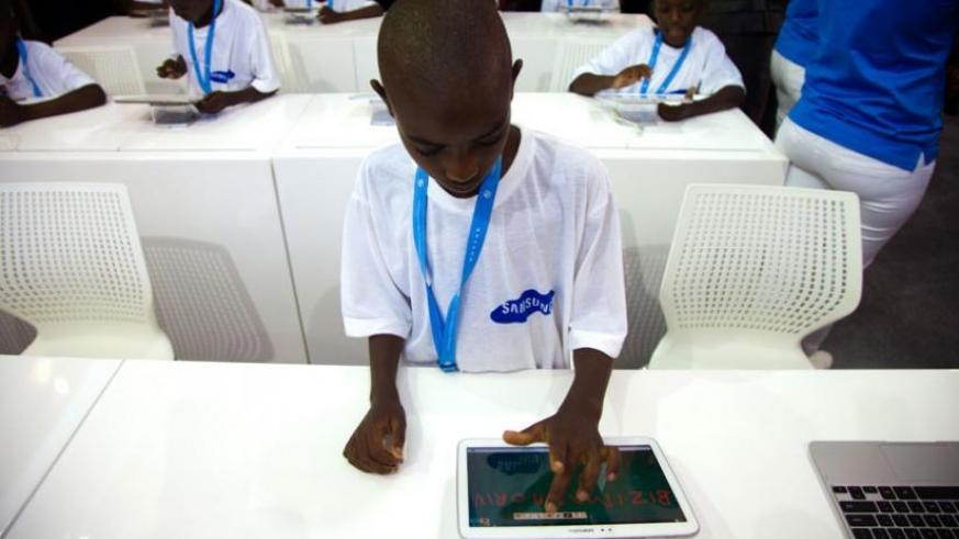 A kid uses a tablet during the 2013 Transform Africa Summit in Kigali. (File)