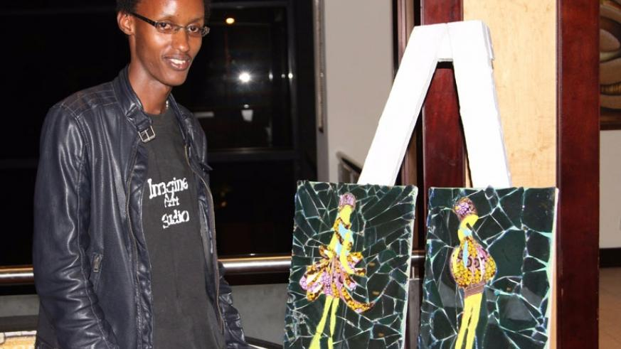 Kayiranga stands next to some of his art pieces. (Julius Bizimungu)
