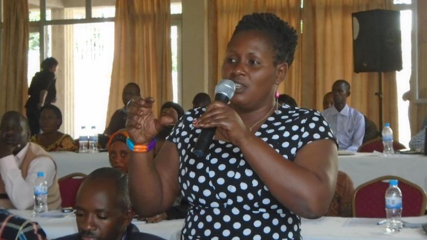 A participant asks a question during the meeting in Huye District, last week. (Courtesy)
