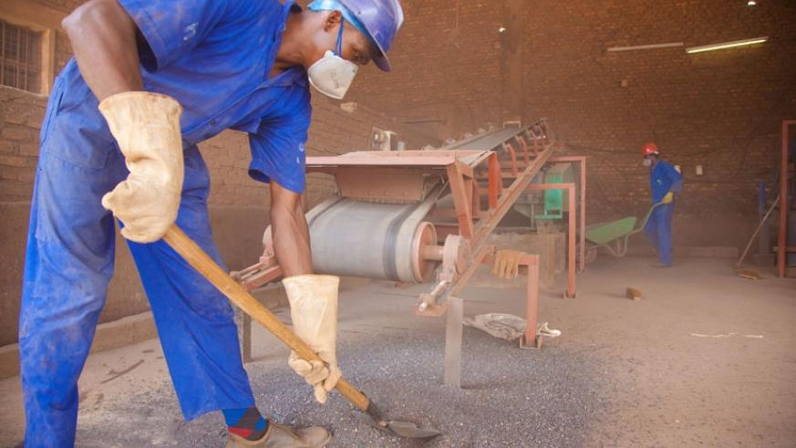 A worker sorts minerals at Mineral Supply Africa offices at Gikondo. (File)