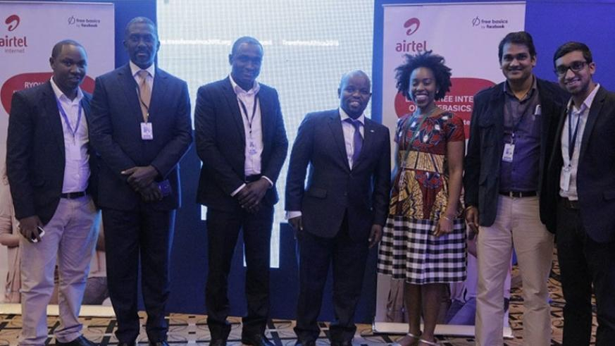 The Airtel Rwanda team pose for a photo with the Minister for Youth and ICT, Jean-Philbert Nsengimana (middle) at the launch of Facebook app during the Transform Africa summit yesterday. (Courtesy)