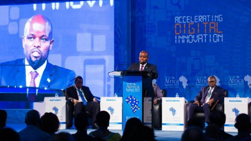 Youth and ICT Minister Jean Philbert Nsengimana (C)speaks during the summit as Dr Fred Matiangi, the cabinet secretary, Ministry of Information, Communications and Technology (ICT)  in Kenya (L ) and Gabon's deputy Prime Minister Flavien Nziengui Nzoundou (R) look on. (Timothy  Kisambira)