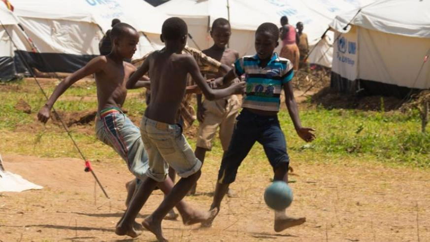 Burundian children play football at Mahama Refugee Camp. With the new developments at the camp, children will be able to get an education. (Timothy Kisambira)