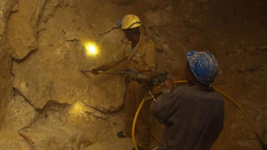 Miners in a tunnel at Gatumba mining centre in Ngororero District. (Timothy Kisambira)