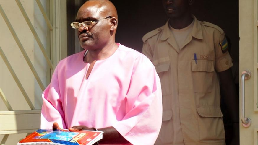 Uwinkindi leaves court at the start of his trial in 2012. (File)