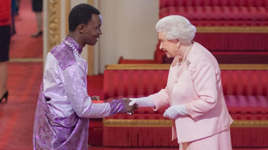 Jean d'Amour Mutoni receiving the Young Leader's Award from Queen Elizabeth II at Buckingham Palace in June this year. (Courtesy)
