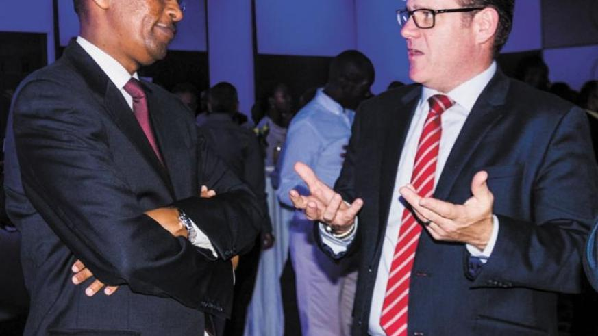 Rwangombwa and Bairstow  chat during the event. I&M Bank unveiled new mortgage products on Thursday. (Teddy Kamanzi)
