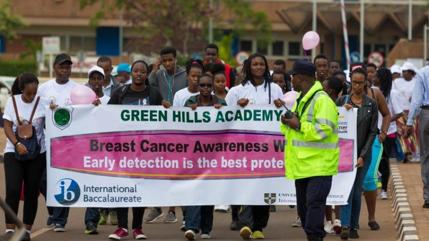 Students of Green Hills Academy join other activists in a cancer awareness march on Sunday. (Timothy Kisambira)