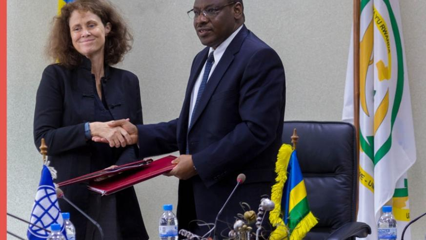 Carolyn Turk, the outgoing World Bank country manager (L) exchange documents with Finance Minister Gatete after the signing ceremony in Kigali yesterday. (All photos by Timothy Kisambira)
