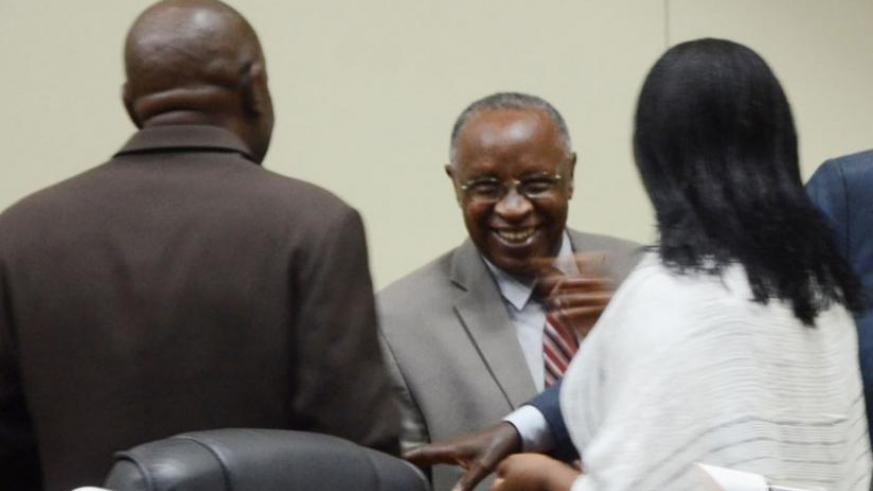 Bishop (Rtd) John Rucyahana (C), the president of NURC, shares a light moment with lawmakers after the meeting yesterday. (Sam Ngendahimana)