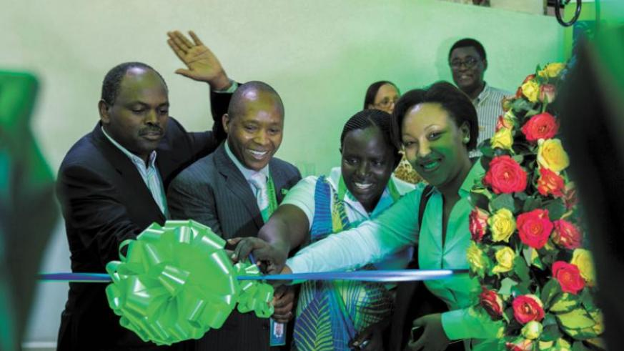 Toroitich (second left) is joined by board members, Dan Zitunga, Specioza Ayinkamiye and Molly Rwigamba, to cut the ribbon at the launch of the new branch at Nyarutarama. (Timothy Kisambira)