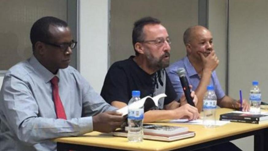Philippe Brewaeys (C), a Belgian journalist and author, speaks  at the launch of two books about Genocide against Tutsion Wednesday.  With him are Dr Bizimana (L) and fellow author Toch. (Jean d'Amour Mugabo)