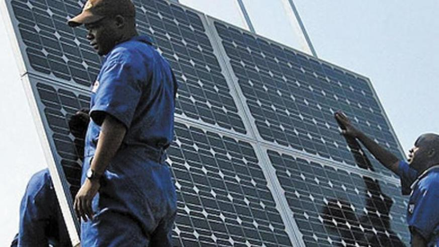Technicians install solar panels. The annual iPAD forum aims at showcasing investment opportunities in Rwanda's infrastructure sector. (Net photo)