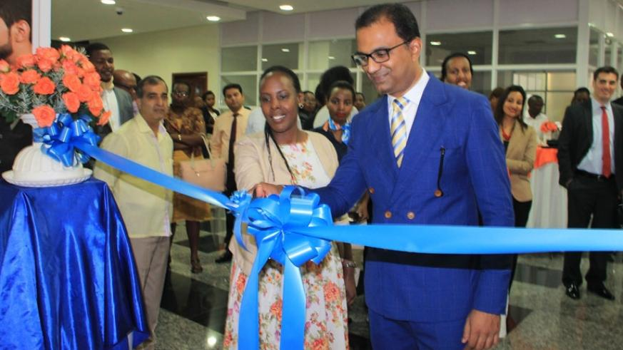 Seerdharan is joined by Linda Mutesi, the Rwanda Development Board head of tourism marketing, to cut the tape at the launch of the flydubai local head office in Kigali last week. (Peterson Tumwebaze)