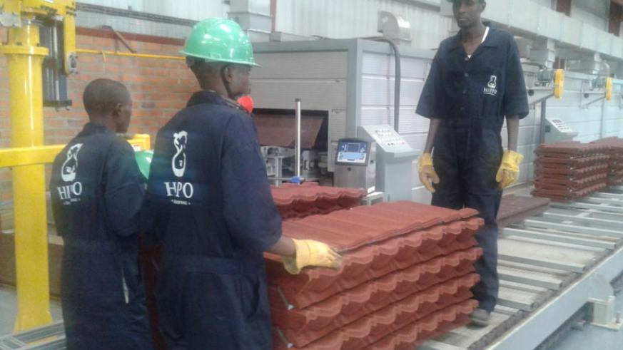 Workers arrange tiles at the Kigali Special Economic Zone based plant. (Peterson Tumwebaze)