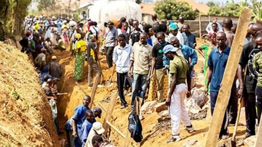 Some Rwandan citizens construct a drainage system during a past Umuganda activity. (File)
