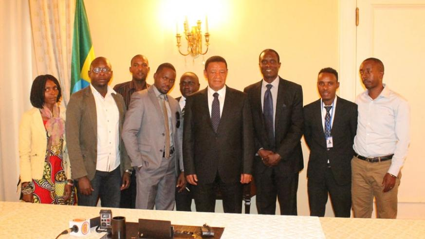 Journalists pose for a photo with Ethiopia's President Dr Mulatu Teshome at his Palace in the Capital Addis Ababa after the interview session. (Courtesy photos)