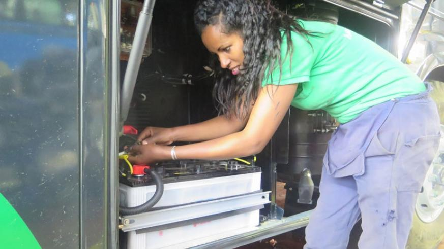 An Ethiopian female technician working on the lighting system of a bus. Forty percent of workers at Ethiopia's Bishoftu Automotive Industry (BAI) are women with vocational training. (Kenneth Agutamba)