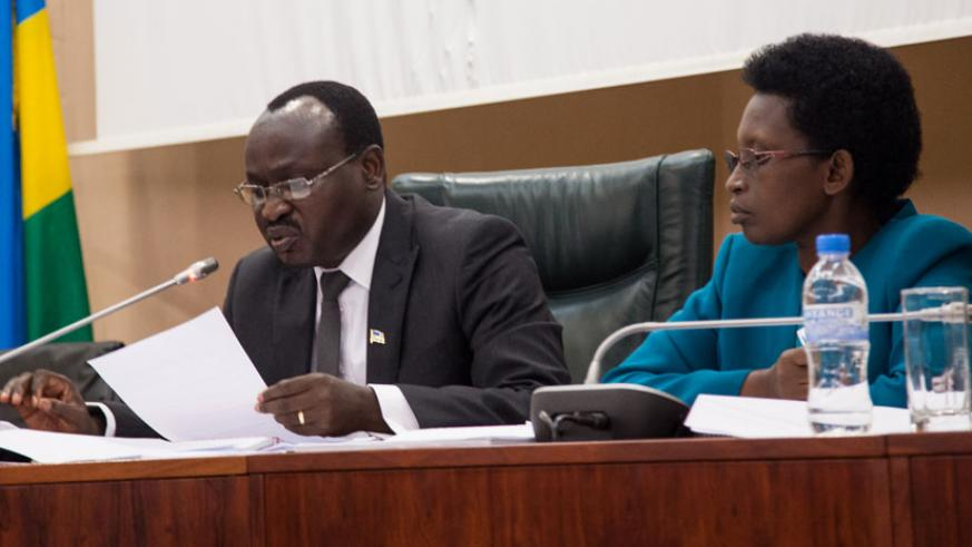 Chairman of the Constitutional Review Commission Senate Jean Nepomuscene Sindikubwabo and his deputy ,Gertrude Kazarwa, during the discussion yesterday. (Faustin Niyigena)