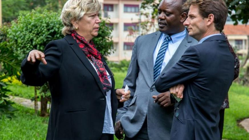 FAO's agricultural research officer Karin Nichterlein speaks to Dr Otto Vianney Muhinda (C), the assistant representative in charge of programmes at FAO Rwanda, and Arnaud DE Vanssay, the second secretary to the head of section rural development at European Union Rwanda. (Doreen Umutesi)