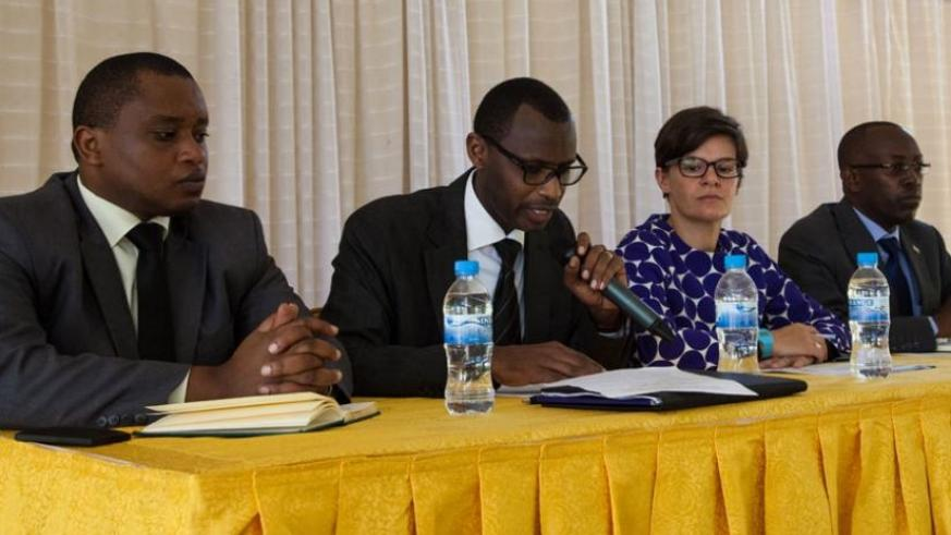 Minister for Education Papias Musafiri (2nd left) opens the workshop yesterday. With him is the State Minister for Primary and Secondary Education, Olivier Rwamukwaya (L), the head of UK's DFID, Laure Beaufils (2nd right) and the permanent secretary at the Ministry, Celestin Ntivuguruzwa (R). (Faustin Niyigena)