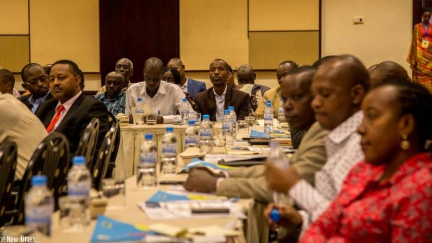 Participants follow a presentation on HIV AIDS prevalence in cities yesterday at Serena Hotel. (Doreen Umutesi)