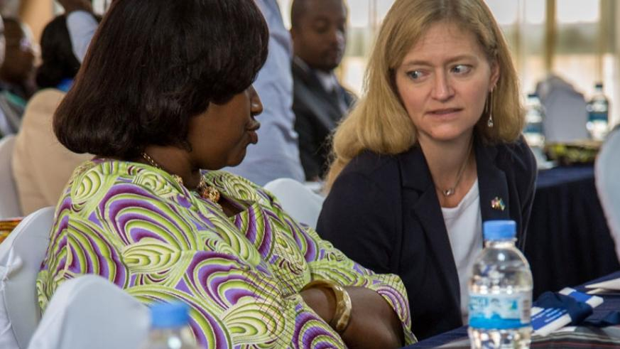 The United States ambassador to Rwanda, Erica Barks Ruggles (R), chats with Dr Agnes Binagwaho, the Minister for Health during the launch of a new Maternal and Child Survival Programme in Kigali yesterday. (All photos by Doreen Umutesi)