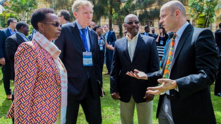 L-R; Dr Gasingirwa, Victor Van Der Chijs, the president of Executive Board of University of Twente; Prof. Manasse Mbonye, the Principal College of Science and Technolgy at the Univeristy of Rwanda, and Prof. Cotton chat on the sidelines of the conference. (Faustin Niyigena)