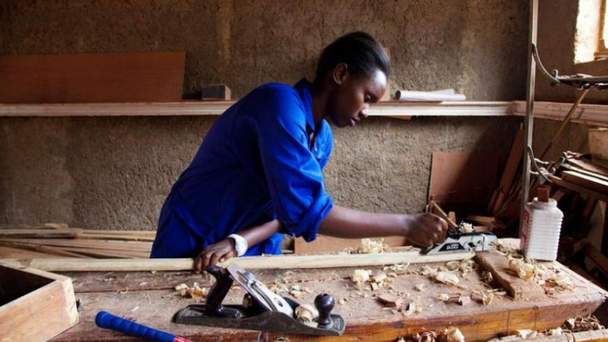 A student files wood at IPRC workshop in Kicukiro. (File)
