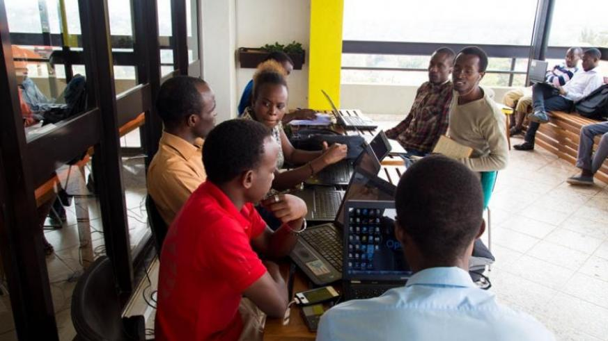 Software developers at K-Lab.  With the ICT innovation fund, more enterprises will get a boost. (Timothy Kisambira)