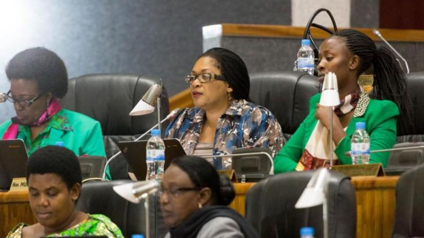 Members of Parliament follow proceedings at the Lower House yesterday. (T. Kisambira)