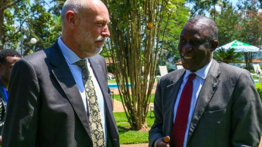Cauwenbergh (L) chats with Maiga during a break at the workshop in Kigali yesterday. (Timothy Kisambira)