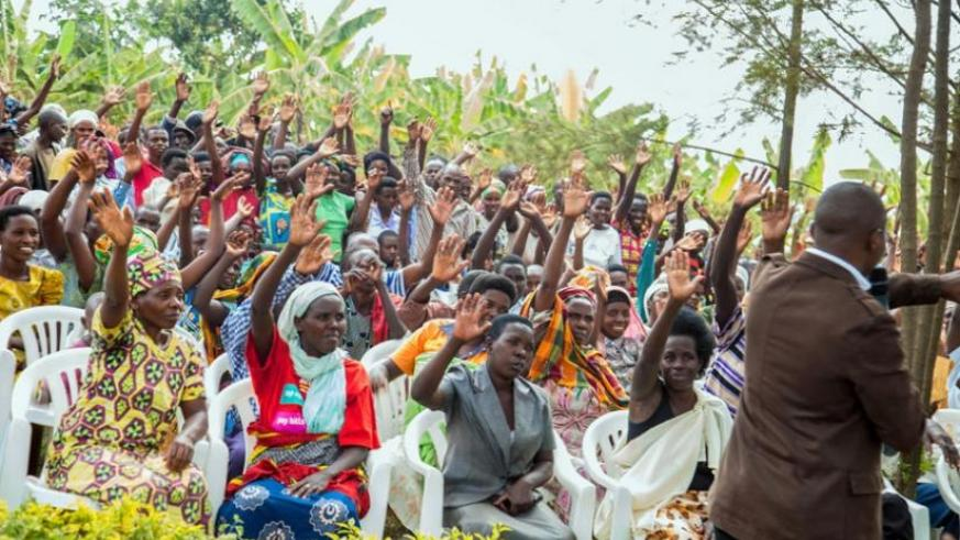 Residents of Gikomero Sector in Gasabo District vote for the removal of term limits  during consultation sessions with Members of Parliament in July. (File)
