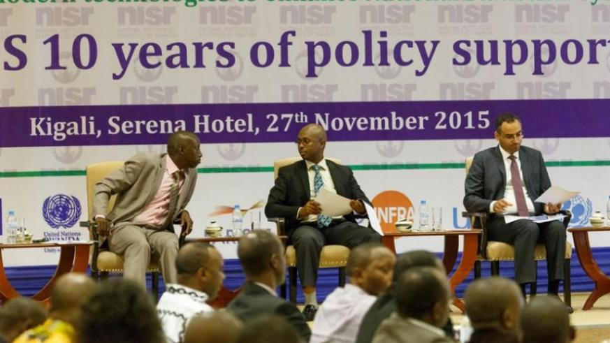 L-R; David Nkusi, the head of corporate services at the National Institute of Statistics of Rwanda (NISR), Murangwa and Alemu at the celebrations to mark African Statistics Day in Kigali yesterday. (Timothy Kisambira)
