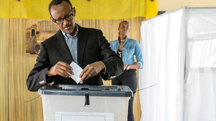 President Kagame casts his vote at APE-Rugunga polling station in Kigali yesterday. (Village Urugwiro)
