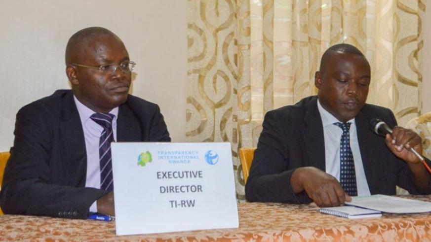 Mupiganyi  (L) and Musangabatware at the release of the report in Kigali yesterday. (Courtesy)