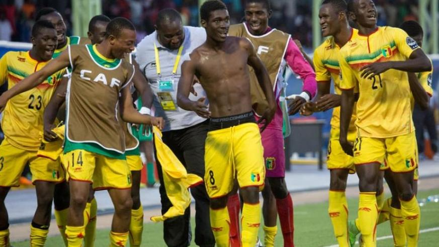 Yves Bissouma (shirt-less) leads his teammates in celebrations after scoring  the only goal in Mali's 1-0 win over Ivory Coast 1-0. (Timothy Kisambira)