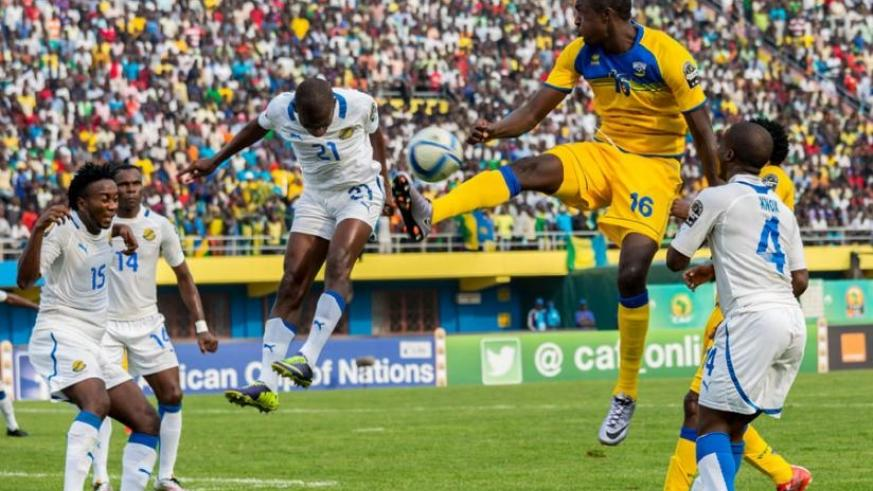 Amavubi striker Ernest Sugira (C), jumps to control the ball in a game against Gabon. He scooped the Man of the Match Award after a 2-1 win against Gabon. (T. Kisambira)