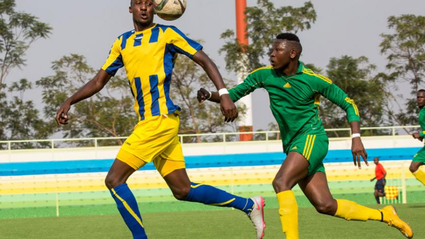 AS Kigali forward Ernest Sugira (left) scored the only goal to keep his team on top of the league table with a 1-0 win over Marines on Friday. (Timothy Kisambira)
