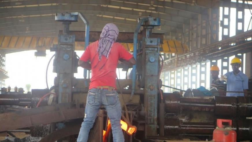 Imana Steel workers say they lack special gear for protection during work. (F. Byumvuhore)