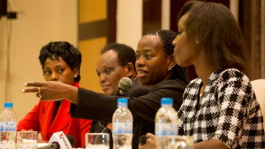 The Chairperson of 'New Faces New Voices' Rwanda Chapter, Monique Nsazabaganwa, addresses the media as Tumi Frazier, a renowned South African leadership and change expert (L), Ignace Rusenga of IFC, and Mireille Karera, the Global Women's Summit event director, look on in Kigali yesterday. (Timothy Kisambira)