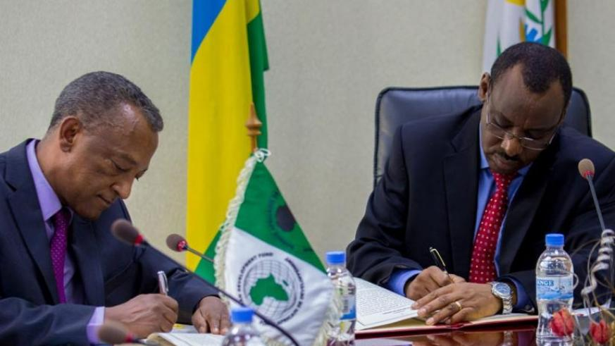 Negatu Makonnen and Minister Gatete sign the loan agreement yesterday.  Ruzizi III is shared by Rwanda, Burundi, and the Democratic Republic of Congo (DRC) and is expected to generate more than 147MW of electricity. (T. Kisambira)