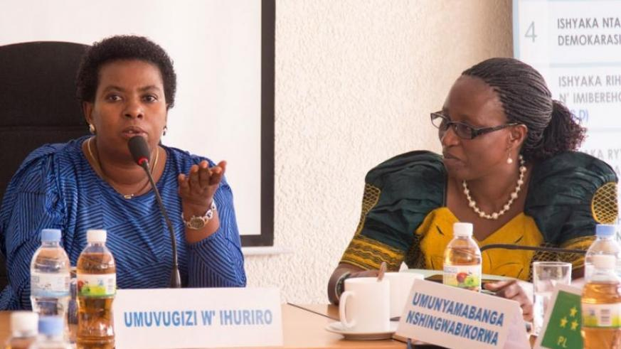 Mukabunane gives her remarks after being elected as the Spokesperson for NFPO while looking on is the outgoing spokesperson Nyirahirwa. (Doreen Umutesi)