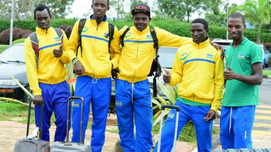 Team Rwanda riders at Kigali International Airport on arrival from Algeria on Wednesday afternoon. (Courtesy)